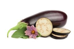 Sliced eggplant or aubergine vegetable with flower isolated on white background.  Royalty Free Stock Image