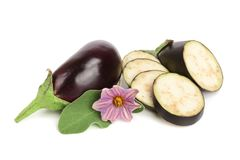 Sliced eggplant or aubergine vegetable with flower isolated on white background.  Royalty Free Stock Photo