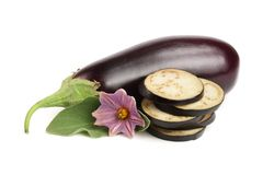 Sliced eggplant or aubergine vegetable with flower isolated on white background.  Royalty Free Stock Photos