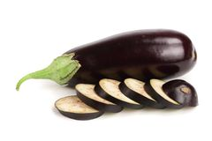 Sliced eggplant or aubergine vegetable isolated on white background.  Stock Images