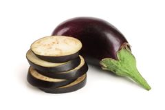 Sliced eggplant or aubergine vegetable isolated on white background.  Royalty Free Stock Photos