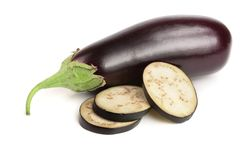 Sliced eggplant or aubergine vegetable isolated on white background.  Royalty Free Stock Image