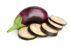 Sliced eggplant or aubergine vegetable isolated on white background.  Royalty Free Stock Photo