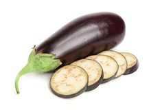 Sliced eggplant or aubergine vegetable isolated on white background.  Stock Photos