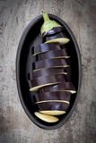 Sliced Eggplant in Black Dish Royalty Free Stock Photography