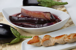 Sliced eggplant in marinade. And meet screwer Stock Photography
