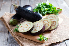 Sliced eggplant on wooden cutting board Royalty Free Stock Images