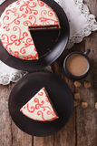 Sliced festive red velvet cake and coffee close-up on the table. Royalty Free Stock Photo