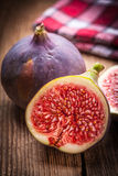 Sliced figs on a wooden table. Stock Image