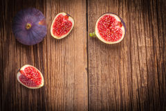 Sliced figs on a wooden table. Royalty Free Stock Photo