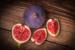 Sliced figs on a wooden table. Top view. royalty free stock photos