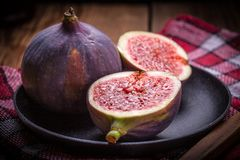 Sliced figs on a wooden table. Top view. stock image