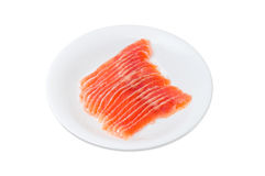 Sliced fillet of salted rainbow trout on the white dish. On a light background Royalty Free Stock Photography