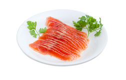Sliced fillet of salted rainbow trout on a white dish stock image