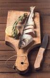 Sliced fish on cutting board Stock Photo