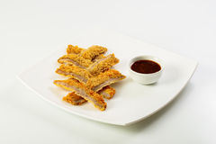 Sliced fish sticks and souce Royalty Free Stock Photos