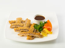 Sliced fish sticks and souce Royalty Free Stock Image