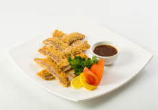 Sliced fish sticks and souce Stock Photography