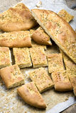 Sliced Focaccia Bread. Sliced foccacia bread with rosemary and olive oil out of the oven on wooden rustic table Stock Photo