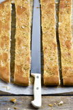 Sliced Focaccia Bread and Knife Stock Photo