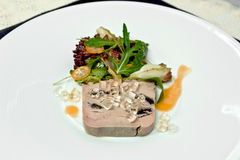 Sliced foie gras with sauce Stock Image