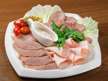 Sliced food  meat and sausage arrangement . Royalty Free Stock Photography