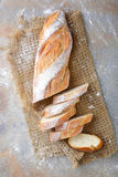 Sliced French Baguette on the sackcloth Royalty Free Stock Image