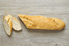 Sliced French loaf bread on a wooden board Stock Photo