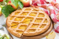 Sliced fresh apple pie on white wooden table Royalty Free Stock Image