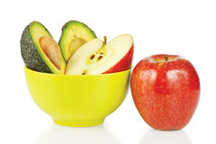 Sliced fresh apples and avocado in ceramic cup Royalty Free Stock Image