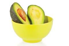 Sliced fresh avocado in ceramic cup Royalty Free Stock Photo