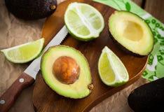 Sliced fresh avocado on cutting board Royalty Free Stock Photos