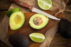 Sliced fresh avocado on cutting board Stock Image