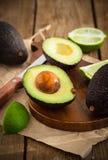 Sliced fresh avocado on cutting board Stock Photo