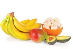 Sliced fresh avocado, mango, bananas and candies Royalty Free Stock Photo