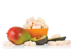 Sliced fresh avocado, mango and candies Royalty Free Stock Images