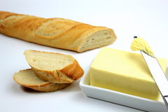 Sliced fresh baguette and butter.  Stock Photos