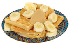 Sliced Fresh Banana on Waffles with Peanut Butter Stock Image