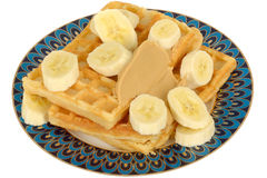 Sliced Fresh Banana on Waffles with Peanut Butter Stock Photography