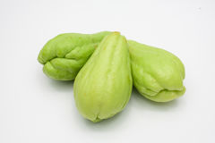 Sliced fresh Chayote and half  on white. Sliced fresh Chayote and half  on white background Stock Photography