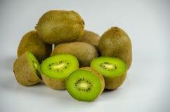 Sliced fresh and juicy kiwi fruit halves on a wooden background.  stock image