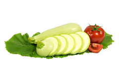 Sliced fresh light green zucchini with tomato on h Royalty Free Stock Photos