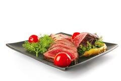 Sliced fresh meat on dark Stock Photography