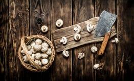Sliced fresh mushrooms old hatchet. Stock Image