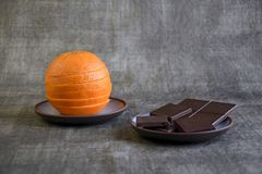 Sliced fresh orange and dark chocolate royalty free stock image