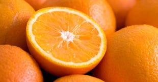 Sliced Fresh Oranges. Sliced and Whole Fresh Oranges royalty free stock images