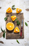 Sliced fresh oranges on the old board. Stock Photo