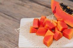 Sliced fresh Papaya fruit on wooden table background.  Royalty Free Stock Photo
