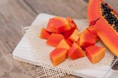 Sliced fresh Papaya fruit on wooden table background.  Royalty Free Stock Image