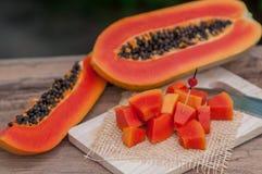 Sliced fresh Papaya fruit on wooden table with nature background.  Stock Photo